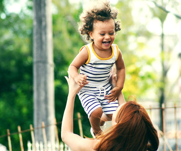 Personal Insurance - Mother and child playing